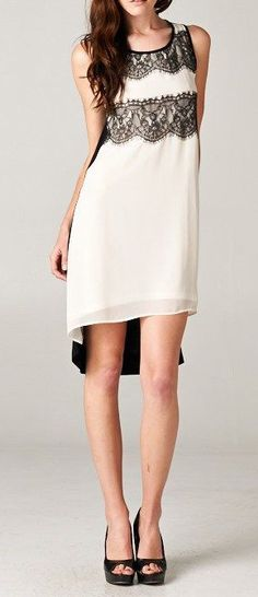 Flowing Woven Chiffon Dress with Lace Contrast and Soft Viscose Back. Lined.