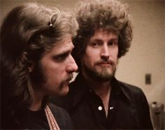 Glenn Frey and Don Henley. Love this!! Glenn is so serious while Don cracks up.
