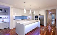 White kitchen with lots of lighting #contemporarykitchen #openplankitchen #glosskitchen