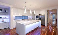 White kitchen with lots of lighting #contemporarykitchen #openplankitchen #glosskitchen