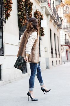 I have this fur vest! I would totally be into anything that could be paired under it... I've been wearing a long navy blouse or a plaid button down.