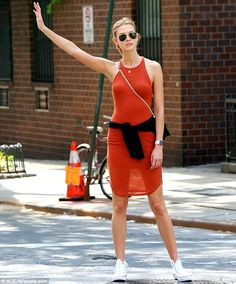 Hailing a cab: The 6ft 1ins model stretched out one of her slender arms to catch the attention of a taxi
