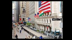 Wall Street -The physical street was put into place long ago, and quite literally: the present day Wall St marks the spot in lower Manhattan where the 17th century New Amsterdam's settlement backed up against a wall.  Financial roots: the area's earliest traders used to gather under a buttonwood tree near the alleged wall to do their business. They eventually named their assoc. the Buttonwood Agreemt — the earliest iteration of the NY Stock Exchange.