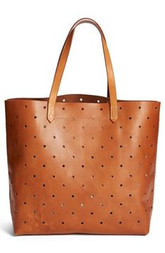 7ef594bb0eed Hole-punch perforations define a rugged everyday tote fashioned from sleek  brown leather. The