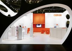 Tradeshow Booth. Love how the outer arch is tilted to draw your eye to the name on the back wall. It's all about the details!