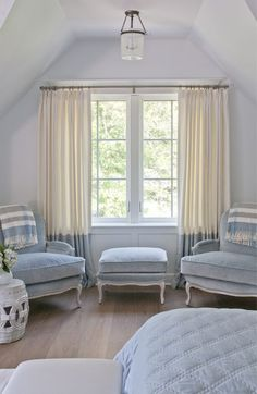 Love the serenity of this room... love the drapes, love the chairs and love the bed cover...Unexpectedly luxurious fabrics but doesn't look at all out of place...