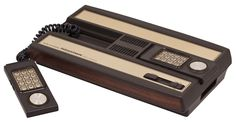 INTELEVISION SET. You see, you could simply slide a flimsy plastic card over the keypad and viola! you are ready to play Frogger. Which I could also beat your ass at.