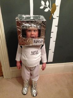 NASA little spaceman for Alien Day dressing up at nursery. An old beer box for helmet and some lemonade bottles and felt for a jet pack!