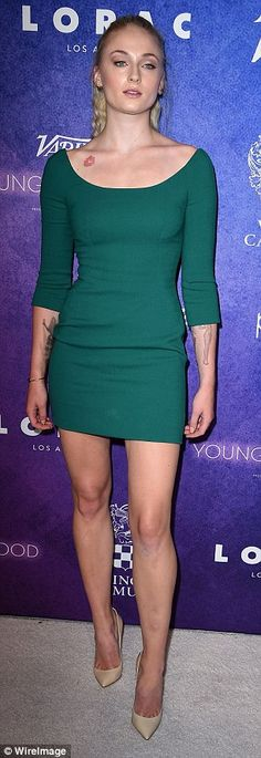 Leggy: Sophie, 20, flaunted her svelte figure in a simple but chic green mini dress...