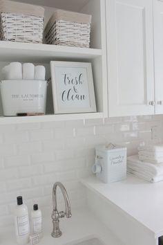 /jshomedesign/ home laundry room, white subway tile, white quartz countertop, patterned tiles