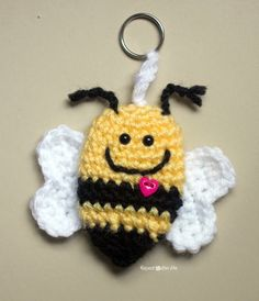 "Here is another ""Bee Mine Valentine"" bumble bee keychain idea. You saw the felt version yesterday and now I am showing you how to crochet one! I have other ideas for this little bee so stay tuned! Materials – Worsted weight yarn. I used Lion Brand Vanna's Choice in Duckie (yellow), black, and white. – …"