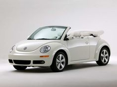 Or, if I wanted to be a little more practical....a new beetle.  I've always wanted a cute convertible!