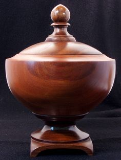 "The body is cherry and was a reject from a furniture manufacturer. I left a touch of the sap wood on it, I like the contrast. The foot is black walnut. The lid is very nice claro walnut and the finial is the sap wood from the foot. 4.5"" wide and 6"" tall"