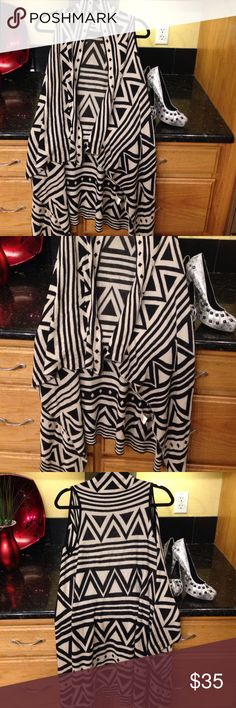 Chelsea & Violet Tribal Print Asymmetrical Vest Super long black and grey tribal print. Sleeveless. Comfy. In excellent condition. Size small but will fit much larger as well Chelsea & Violet Tops Blouses