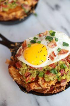 Cheesy Cajun Fries: topped w/ cajun guacamole, #bacon & fried eggs