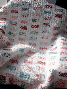 pocket change quilt, coins separated by white + white sashing...could use bella jelly roll solid and scraps or other jelly roll easy peasy!