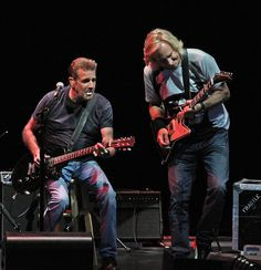Glenn Frey and Joe Walsh of the Eagles perform at the Marcus Amphitheater on Summerfest's closing night Sunday.