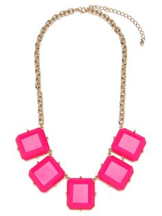 This cool necklace works the simple, sleek side of colorful glamour. It features a series of bight fuchsia gemstones-all cleanly cut in graphic baguette style.