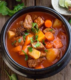 Slow Cooker Homemade Beef Stew makes the perfect comforting meal on a cold day. So easy to make & simmered all day for the best flavors. Our favorite dish.
