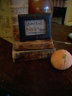 "Primitive styled ""mini"" Pumpkins sampler on Ebay....Seller name: theprimitivestitcher"