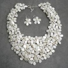 @Overstock - Add some girlish appeal to your wardrobe with this necklace and earrings set, featuring mother of pearl and pearl gemstones. This jewelry was handmade in Thailand by artisan, Lai.  http://www.overstock.com/Worldstock-Fair-Trade/Mother-of-Pearl-and-Pearl-White-Mini-Floral-Jewelry-Set-5-8-mm-Thailand/5608572/product.html?CID=214117 $96.29