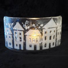 Fused glass row of white houses - a candle screen with flecks of snowy white and silver stars. Handmade Christmas decoration snow scene.