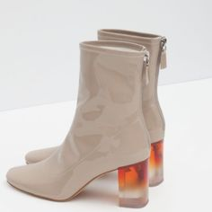 Zara clear heel booties never worn I was absolutely obsessed with these Zara boots when I saw them suggested as a Dior knockoff, I bought them, but they're a little too tight. Fashion Heel Ankle Boot. Color: Tan. Material: Vinyl. Zara Shoes Ankle Boots & Booties
