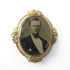 shopgoodwill.com: Antique Tin Type Photo Brooch with Beveled Glass