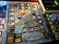Lords of Waterdeep: worker placement game. 5 secret lords. piety, arcana, skullduggery, commerce, and warfare quests, coloured cubes, and intrigue cards