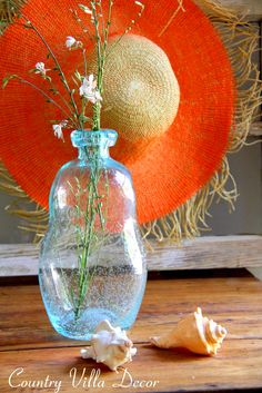 """The Sea Glass Bottle and shells say """"Beach""""...but the bright straw hat adds the tropical flair..."""