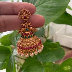 Your place to buy and sell all things handmade Antique gold finished ruby & emerald peacock Jhumkas /Indian jewelry/Women jhumki Earrings / bridal earrings / Temple Jhumka earrings Gold Jhumka Earrings, Gold Bridal Earrings, Jewelry Design Earrings, Gold Earrings Designs, Peacock Earrings, Indian Earrings, Antique Earrings, Gold Temple Jewellery, Gold Wedding Jewelry