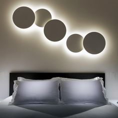 Puck Wall Art Triple Sconce from VIBIA