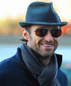 Hugh Jackman demonstrates how a man wears a scarf - he's gawjus in all dark blue!