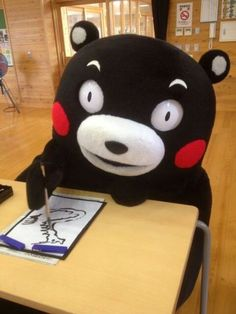 Kumamon working on his art