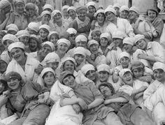 UK, WWI: Women workers of a flour mill at Rank & Sons, Birkenhead, Cheshire, happily pose for the camera in 1918. Working in industry could be hard, monotonous and sometimes dangerous, but there was also a strong sense of camaraderie amongst workers. Wartime conditions saw a greater variety of opportunities for women.