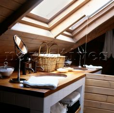 Attic bathroom detail with velux windows