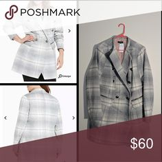 """Torrid plus size coat The brushed white and grey plaid wool on this midi coat not only guarantees that you stay toasty no matter the weather, it's also totally chic. The double breasted closure has menswear vibes with military buttons, a way unique touch. Zip pockets lend functionality.   Model is 5?9.5?, size 1?  Size 1 measures 34 3/4"""" from shoulder  Polyester/wool/acrylic/other fibers  Wash cold, dry low  Imported plus size coat torrid Jackets & Coats Pea Coats"""