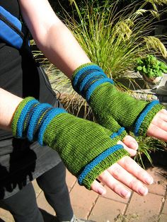 Ravelry: Frankleigh's Io fingerless mitts (in pink and black?)