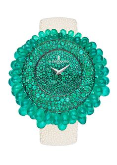 de Grisogono's Grappoli Watch features emeralds that emanate from the centre of the watch growing in size and spilling over the bezel of the watch. Oh my......