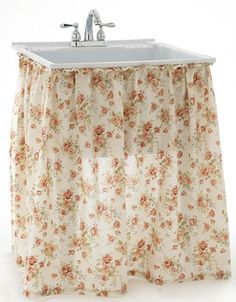 Skirt your laundry room sink with charming fabric.
