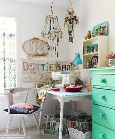 love this artistically well thought out vintage decorated crafting & sewing area