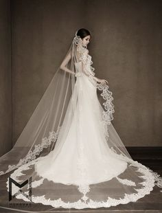 Statement-making, magical bridal veil with incredibly beautiful detailing!