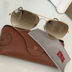 Ray-Ban RB 3025 Gold Aviators Ray-Ban Aviator 3025 RB 3025 001/51 58mm. Gold Frame with Brown Gradient Medium. Few, VERY small chips on top of frame of left lens. (shown in third picture). Can be easily replaced at a Sunglass Hut or through RayBan. Comes with case and cloth. No trades! Willing to negotiate on price. Cheaper through Mercarï Ray-Ban Accessories Sunglasses