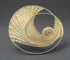 Mary Lee Hu (b. 1943) is an American artist, goldsmith, & educator known for using textile techniques to create intricate woven wire jewelry. This 18k and 22K brooch was made in 2002.