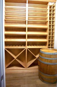 This custom wine cellar in Vancouver, BC was racked out with all solid oak custom racking, combining individual bottle slots, horizontal display shelves and wine barrel. Wine Cellars, Display Shelves, Solid Oak, Vancouver, Barrel, Bottle, Modern, Projects, Home Decor