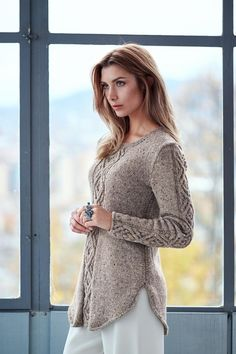 A shadow diamond cable dominates this a-line sweater with a curved flattering hem - download the pattern from LoveKnitting!