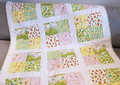 """Strawberry Garden Baby Quilt by bobbinandbaste on Etsy. I like the """"garden"""" patch idea. and the Heather Ross fabric- of course! This concept might be great for using up all of those random florals, but I would think mine would be much louder!!"""