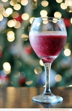Wine Smoothie - A cup of frozen fruit blended with 1 cup of white wine - Great for a hot summer day!