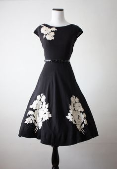 Vintage 1950s black cotton dress with circle skirt & lovely white floral appliques <3 | from Thrush on Etsy
