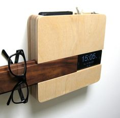 The Butler Organizer by Curtis Micklish  Your phone slides in on the side and has a hidden space for your charging cord.It's made from solid walnut and baltic birch laminated ply.